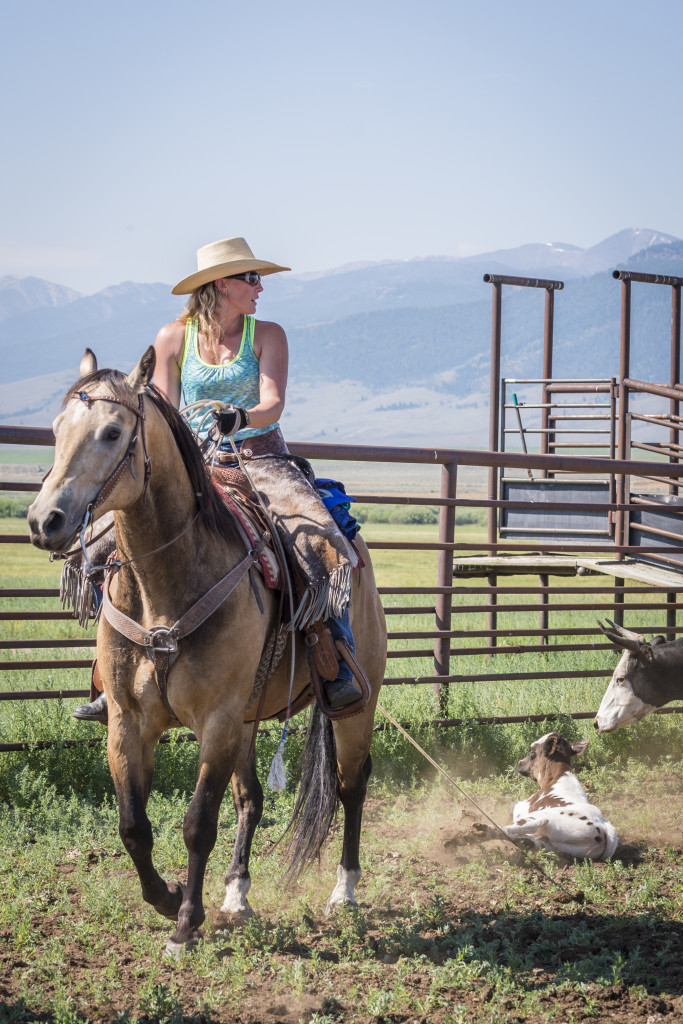 Kristine Tyler bringing in a calf she roped for branding on the Tyler Ranch in Leadore, Idaho. June 30, 2015